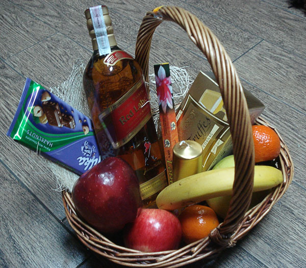 Basket with whisky, fruits and more ...