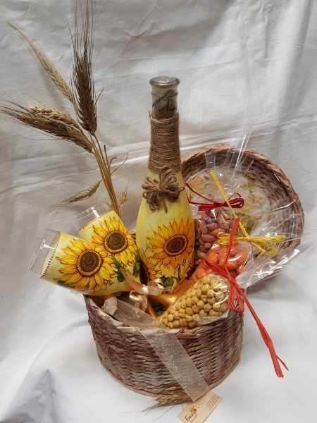 Hand-woven basket with wine and sunflowers