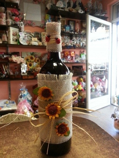Bottle of wine and sunflowers